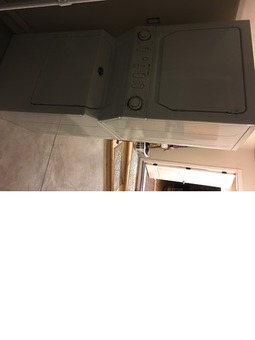 Front loading stacked washer dryer