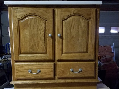 "30"" golden oak bathroom vanity with new white top"